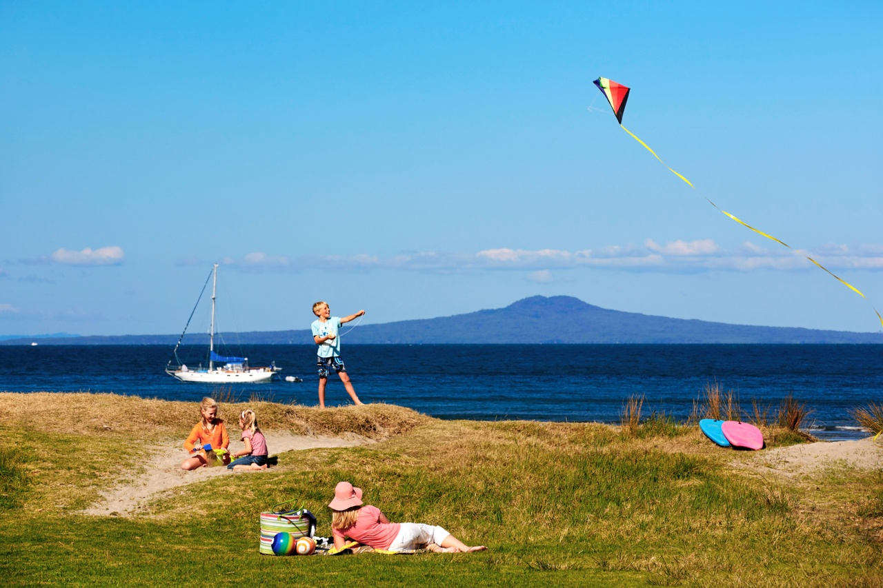 Family enjoying a day out at Shakespear Park in North Auckland