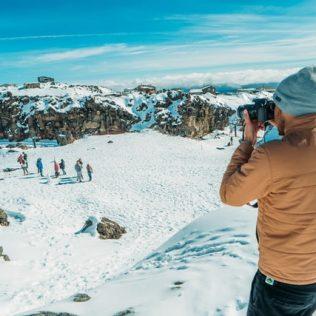 man taking photo in snow