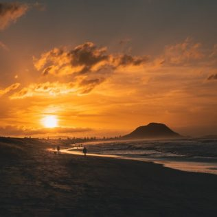 sunset over beach in mount maunganui