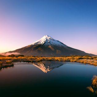 lake in front of mount taranaki